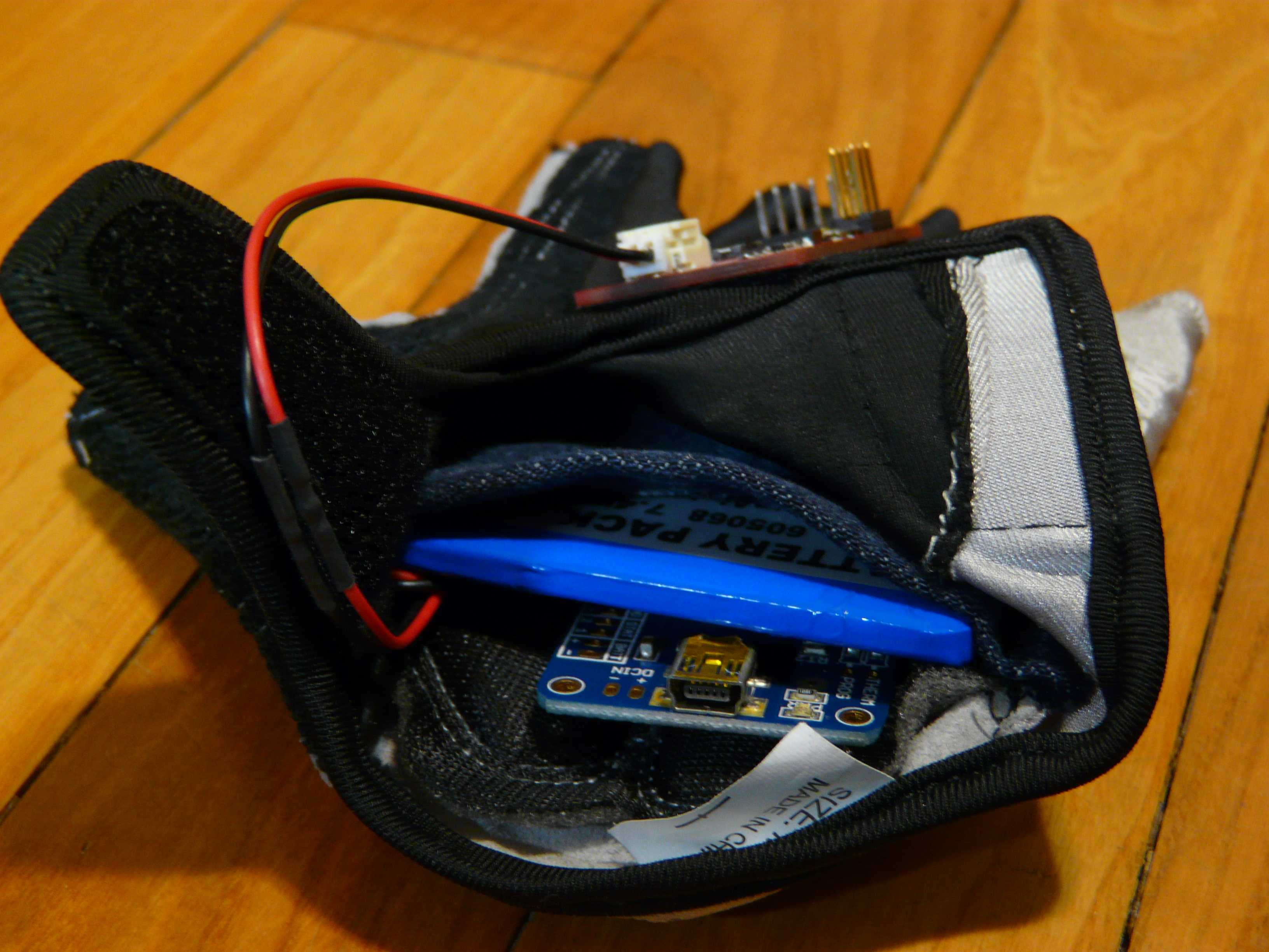 Battery and charger in glove