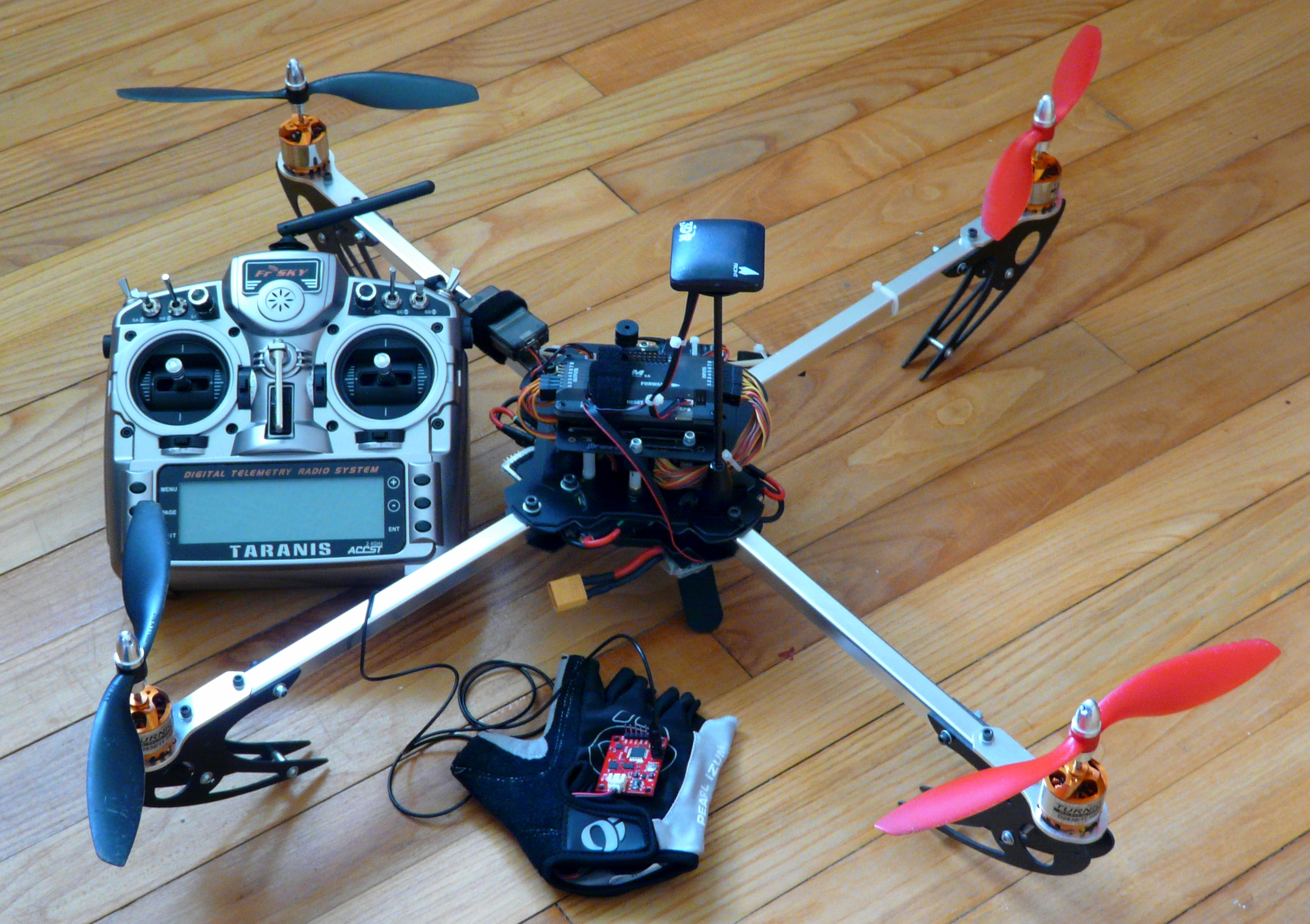Quadcopter, radio transmitter and glove